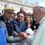 epa04151030 A handout photo provided by the Vatican media service 'Osservatore Romano' shows Pope Francis as he talks to Alcoa redundant workers from Sardinia at the end of his Wednesday's General Audience in Sa